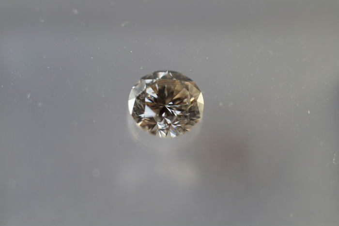 0.20ct Brilliant cut tinted white colour (M) diamond