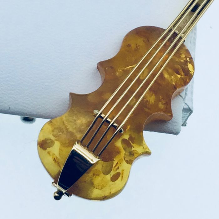 Brooch representing a cello in 750 gold, Amber