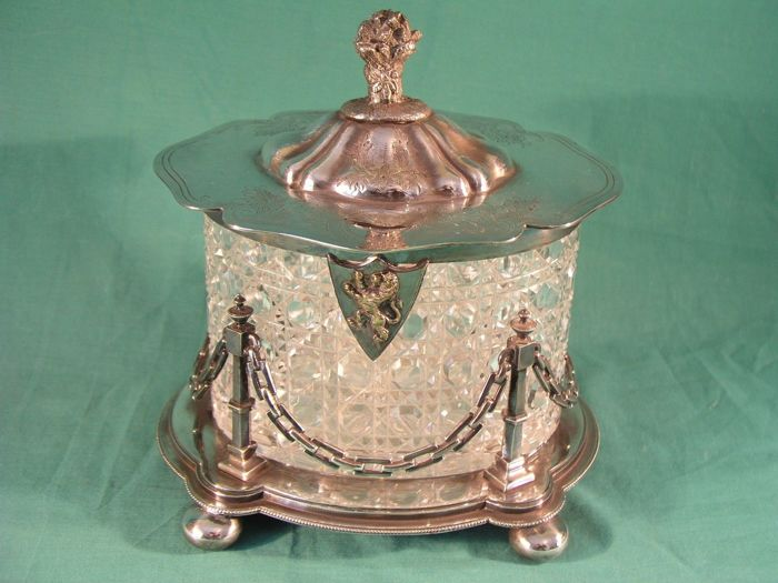 Cookie jar in cut glass with silver plated lid and supporting base, by Walker & Hall