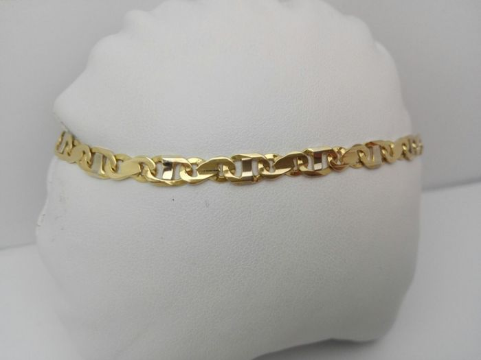 'Vittoriosi' men's bracelet with links in 18 kt white and yellow gold Weight: 11 g