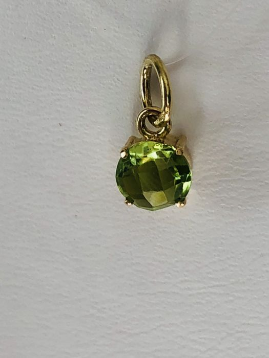 Pendant of 18 kt/750 yellow gold with round cut Peridot of 1.10 ct. &No reserve price&