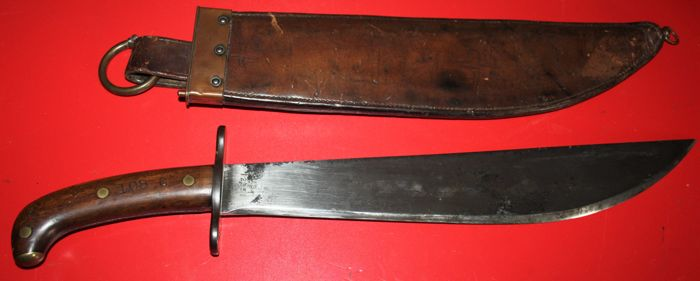 U.S.  M 1909 Bolo knife / machete, Marked S.A., 1911 and numbered, in leather scabbard marked Rock Island Arsenal, in very good condition,rare in this condition
