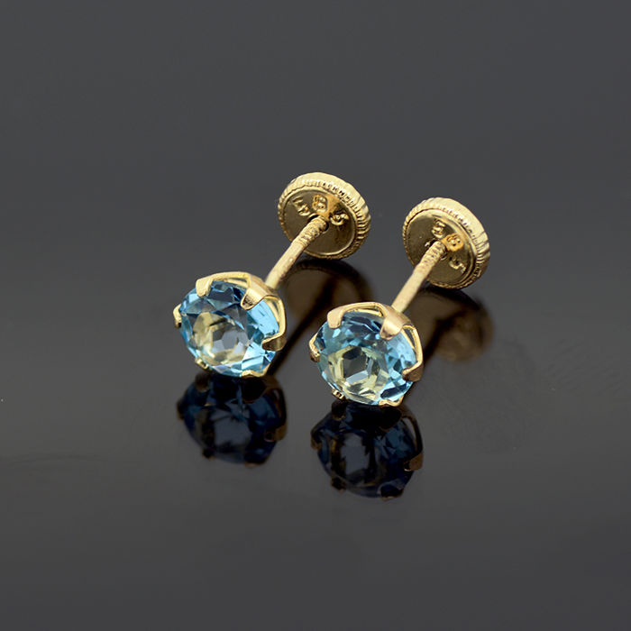 14k/575 yellow gold earrings with two blue topazes - Total gemstones weight 1.36 ct.