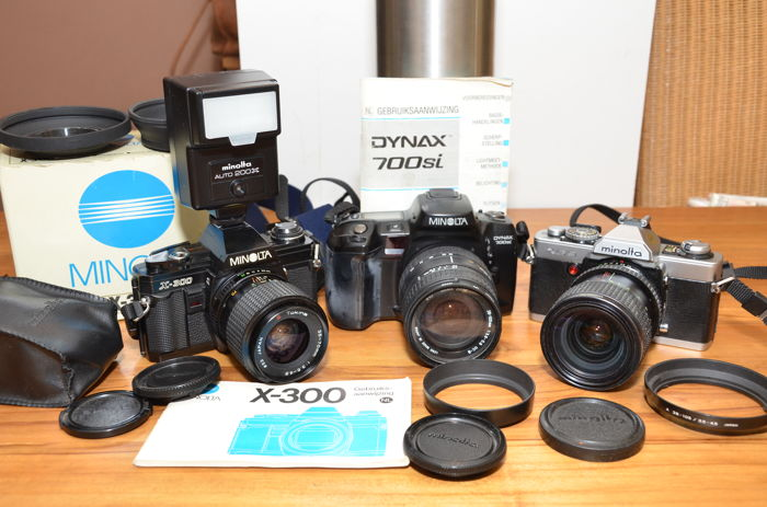 Three Minolta SLR cameras in good, working condition, XG9, X-300 and Dynax 700si with three lenses and Minolta auto 200X flash
