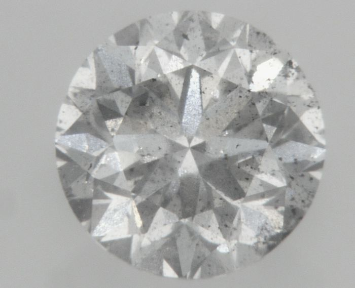 0.75 carat  - D color - SI1 clarity   - Natural Diamond  Comes With Big AIG Certificate + Laser Inscription On Girdle .