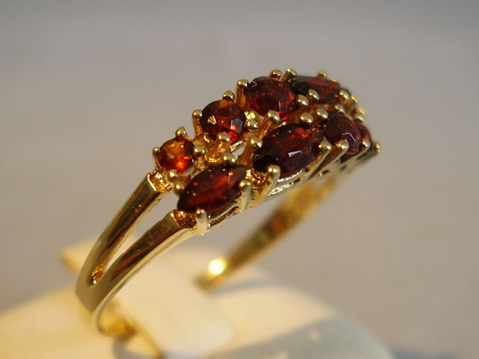 antique golden ring with facetted blood-red Bohemian garnets totalling 2 ct.