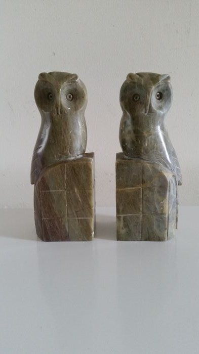 2 marble owls as bookend