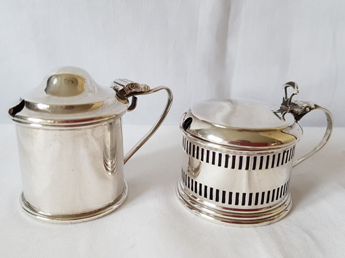 Two silver mustard pots - Britton Gold & Co - 1933, Levi & Salamon - 1920, Birmingham