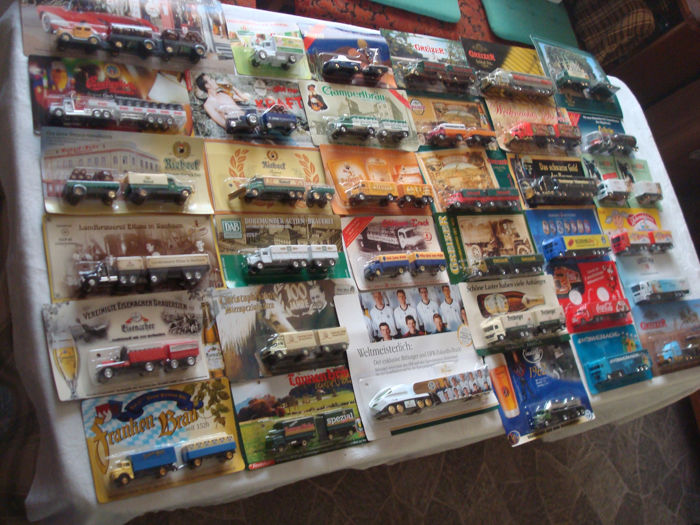 A variety of brands - brewery trucks, advertising trucks, many vintage trucks and rarities, in original packaging, 80 pieces