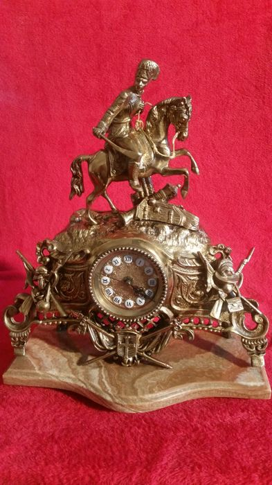 Spectacular clock of bronze alloy with the carved figure of a warrior and his horse French style 20th century