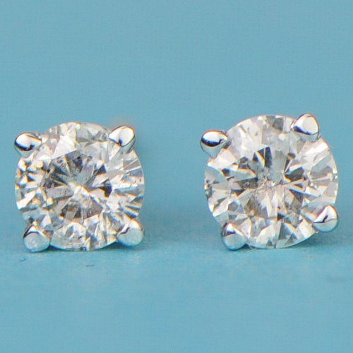 14 kt gold stud earrings with solitaire diamond totalling 0.20 ct - approx. 3 mm