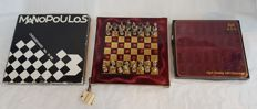 Chess set:  Deluxe chess game with nicely detailed solid metal chess pieces on felt in original packaging. = Greece