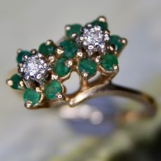 "ca. 1960/70 Handmade ""Toi&Moi""  14kt. gold ring with 12 small Emeralds and 2 diamonds H/SI in decorative flower shape. No reserve"
