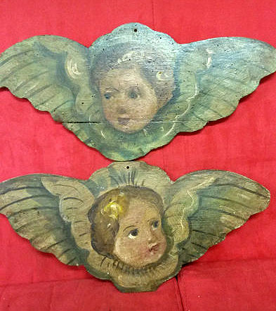 Two winged cherub heads on wood, Northern Italy, 19th century