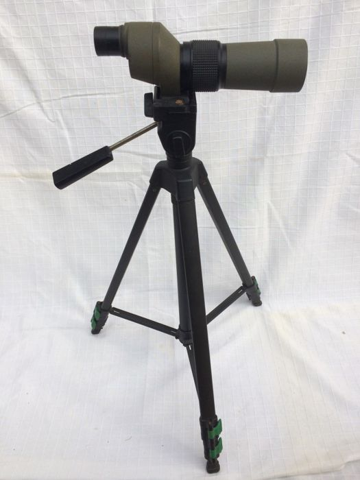 Vintage Kowa target shooting telescope with tripod.