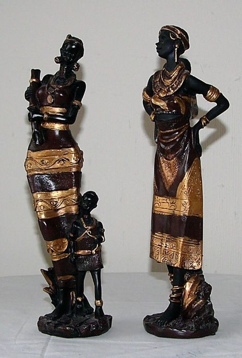 Two beautiful wooden sculptures of African women