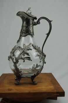 Antique decanter of glass encased  in tin