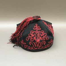 Embroidered smoking cap, red on black. Germany, ca. 1870
