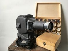 Leitz Prado projector with many films (Rome, Paris, London) and slides