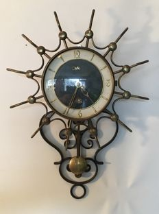 Orfac – decoratively designed mechanical sun clock in Hollywood Regency style