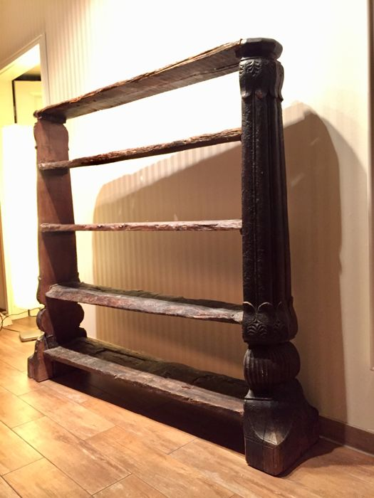 Hardwood shelf made of driftwood and a Balinese wooden pillar from around 1970