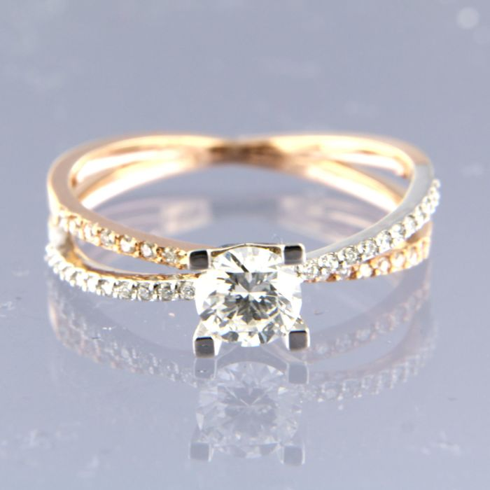 14 kt bi-colour gold solitaire ring set with a central brilliant cut diamond of 0.57 carat and 38 brilliant cut diamonds of 0.13 carat, ring size 17.75 (56)