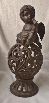 Cast iron breakthrough ball with cherubs