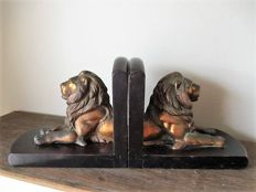 A set of bookends with lions in red copper - 1930