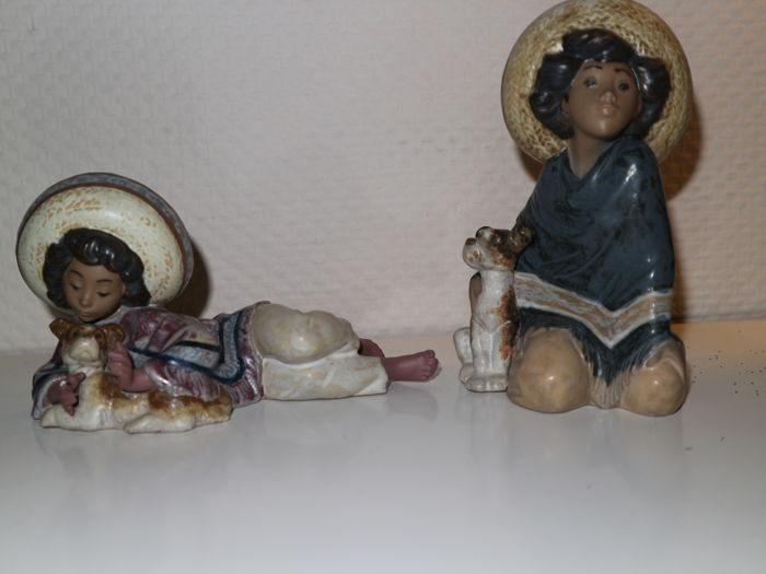 Two Lladro porcelain sculptures - Mexican Boy With Dog (lying down/standing)