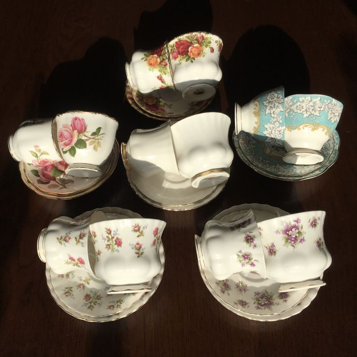 Collection of 12 pieces Royal Albert English cup and saucers (Ladies & Gents)