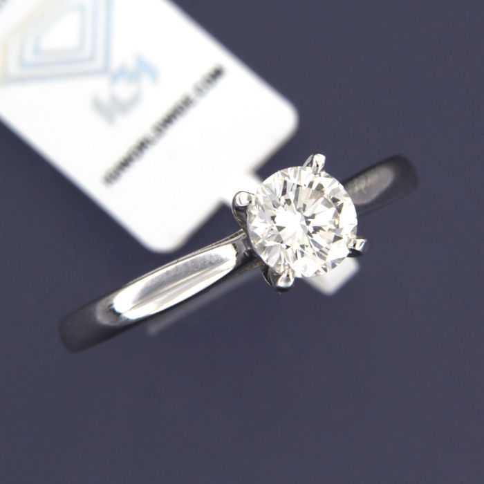 14 kt White gold solitaire ring set with one 0.77 ct brilliant cut diamond, I VVS2
