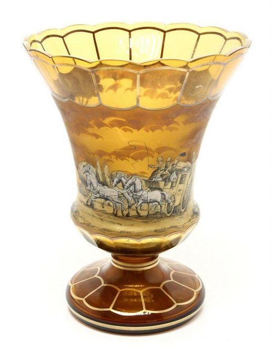 A large enameled amber colored vase