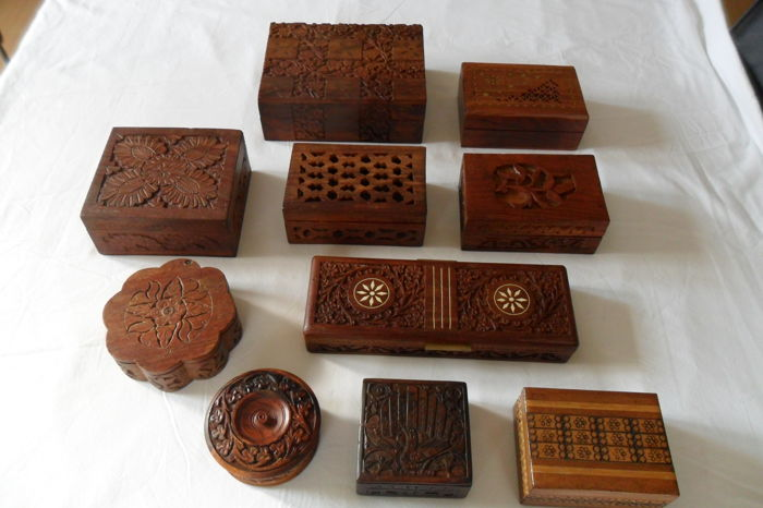Ten hand-carved wooden boxes