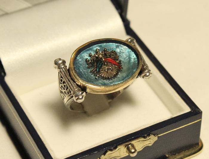 Ring made of silver with heraldry symbol in enamel