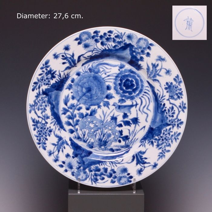 Large blue white porcelain plate - flowers growing out of rocks with bird - China - 18th century (Kangxi period).