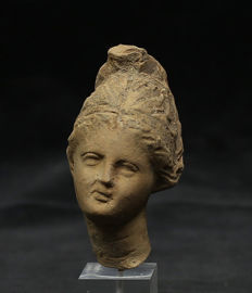 Hellenistic terracotta head of a woman - 64 mm