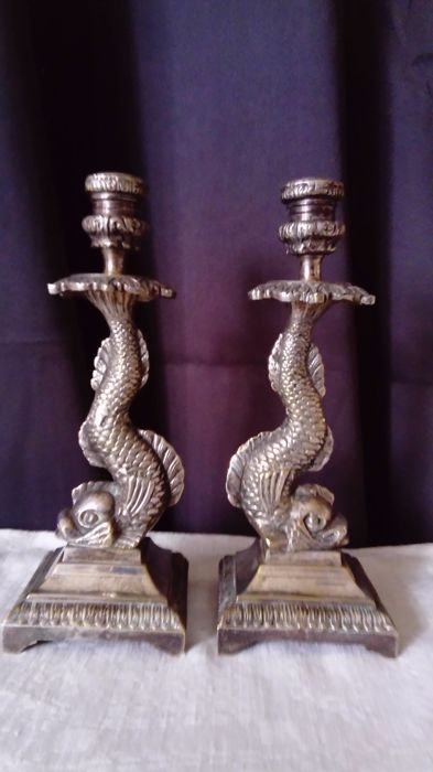 Pair of candlesticks with triton silver metal, early 20th century