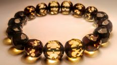 Green tint Faceted Baltic Amber bracelet, hole diameter ca. 54 mm