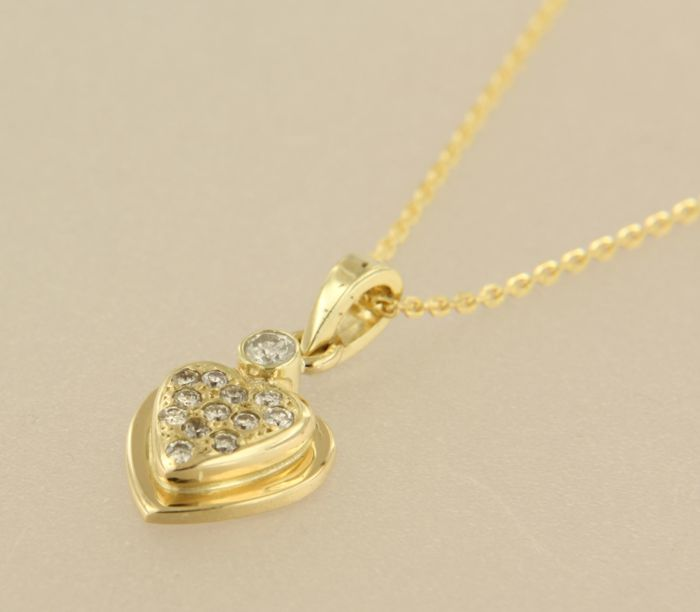 14 kt yellow gold necklace with a gold heart pendant set with 12 14 kt yellow gold necklace with a gold heart pendant set with 12 brilliant cut diamonds aloadofball Image collections