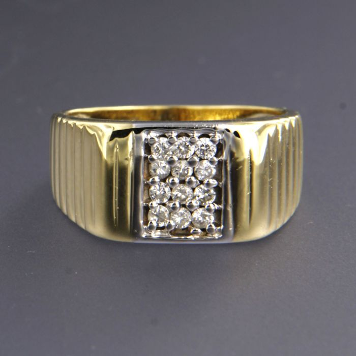 18 kt bicolour gold ring set with 12 brilliant cut diamonds, in total approx. 0.30 carat