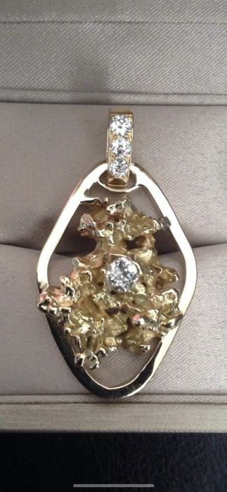 Gold nugget on a pendant with a diamond