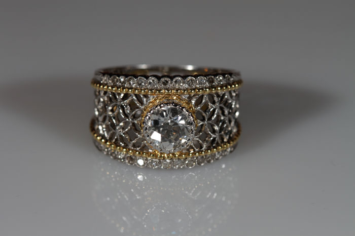 White and yellow gold ring with central diamonds and accent diamonds