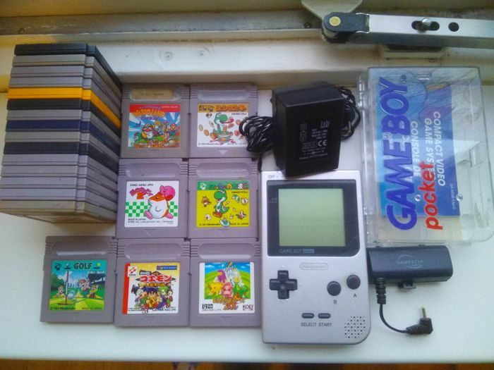 Nintendo Boy Pocket gaming console with accessories and 22 games