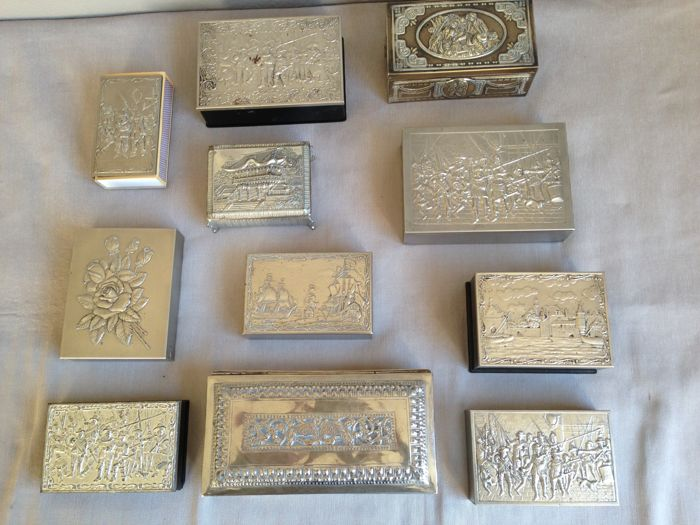 Nice collection of 11 silver-coloured and silver-plated cases