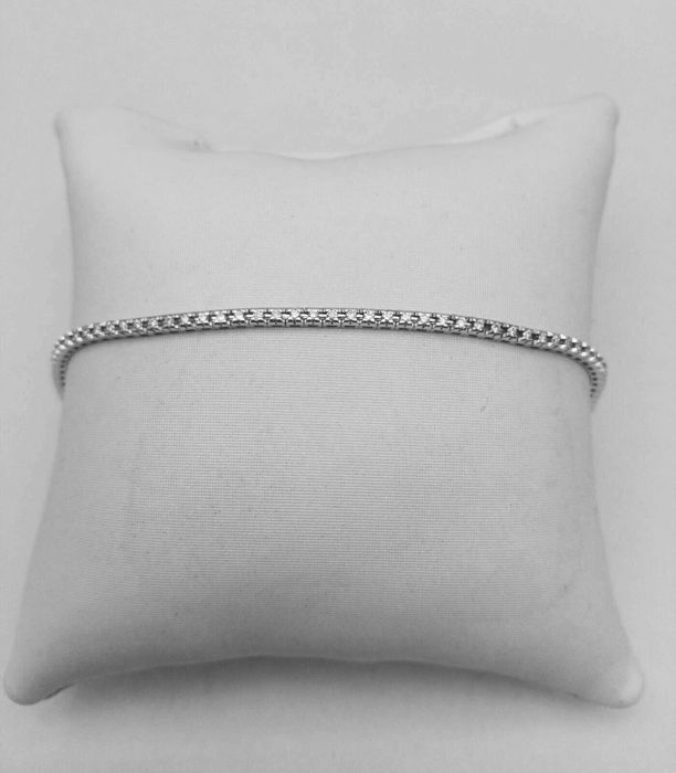 Women's tennis bracelet in 18 kt white gold with brilliant cut natural diamonds totalling 0.56 ct, weight 5 g