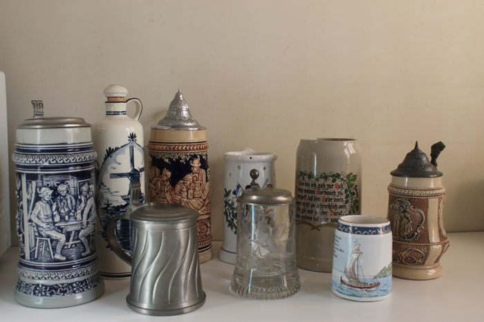 Nice and special collection of beer mugs and a gin bottle.