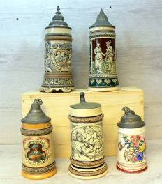 Collection of antique beer mugs with tin lid