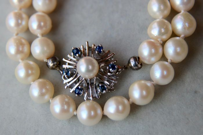 84cm. long Akoya pearl necklace 6.5-7.0 mm with lustrous & genuine sea pearls with a vintage 14Kt white gold lock set with Sapphires