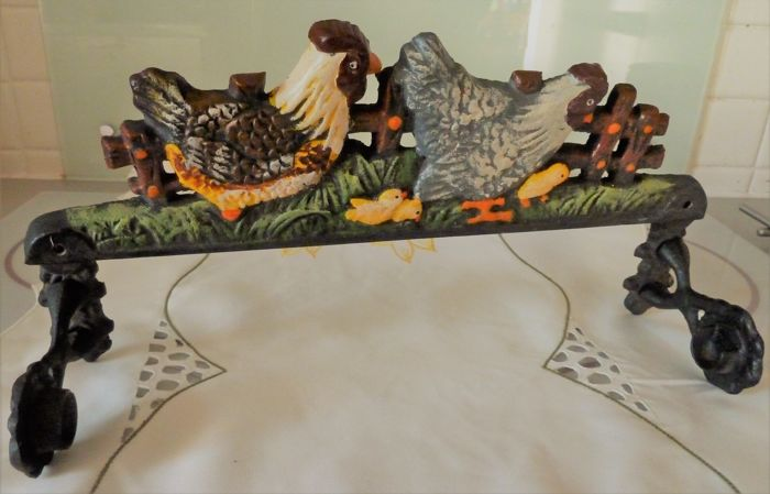 Wall lamp made of cast iron for serviettes on long table runner embroidered with the Easter theme
