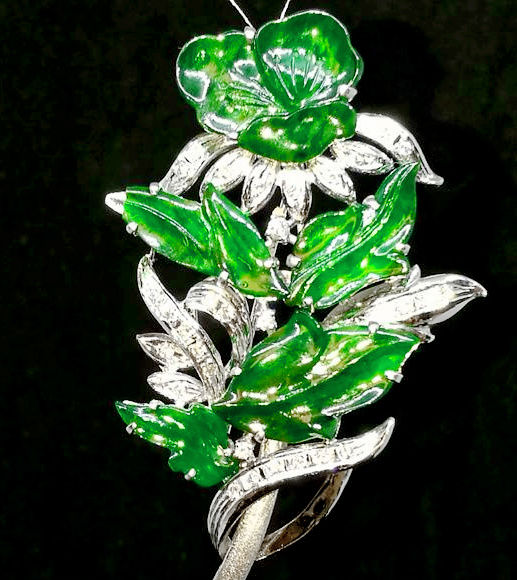 """ A ' type intense green Jadeite with .55ct of diamonds setting in a brooch/pendant"
